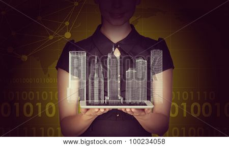 Businesslady holding tablet and 3d city model