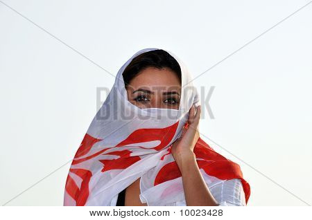 Young Beautiful Woman Covered With Scarf