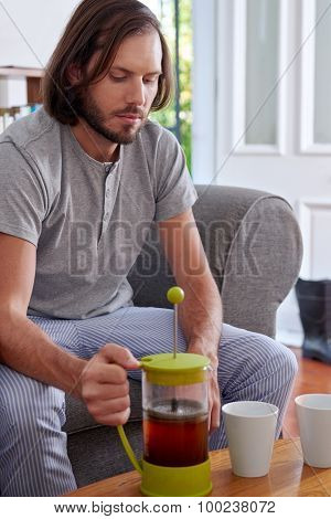 man prepared filter coffee for the early morning breakfast in home living room lounge