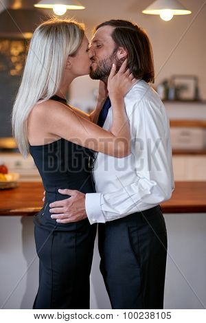 romantic affectionate young couple morning kissing goodbye for work at home