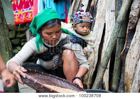 HaNhi ethnic minority woman with her child in Laocai, Vietnam