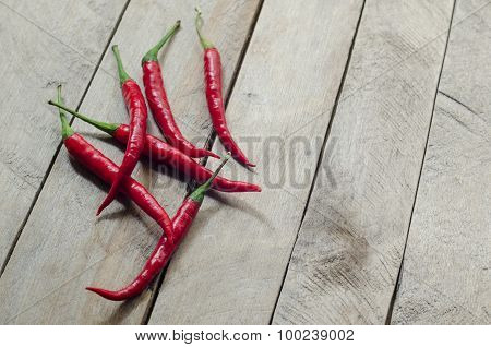 Red chili on an wooden background.