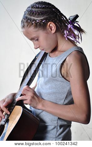 Young Teenage Girl With Guitar