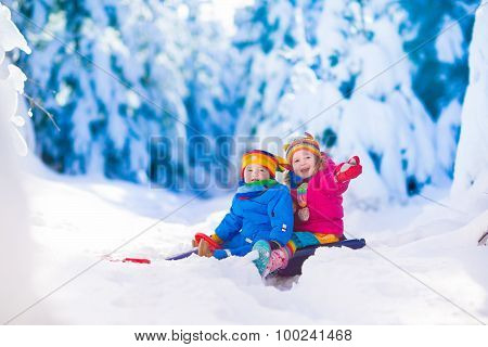 Kids Having Fun On A Sleigh Ride In Snow