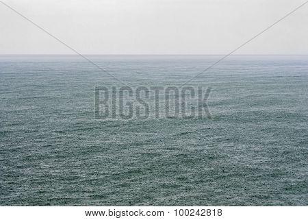 Rain Shower On Open Sea