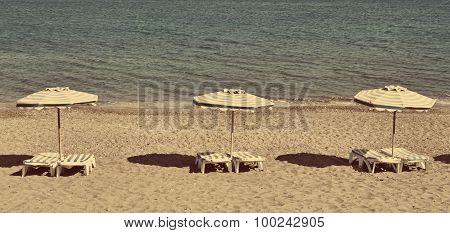 Greece. Kos. Kefalos Beach. Chairs And Umbrellas. In Instagram Style