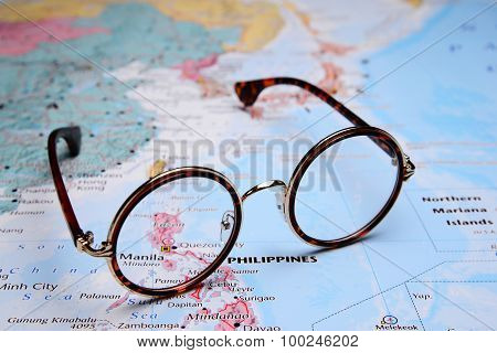 Glasses on a map of Asia - Manila