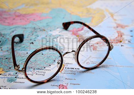Glasses on a map of Asia - Shenzen