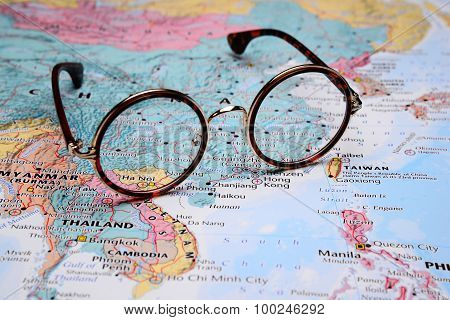 Glasses on a map of Asia - Hanoi
