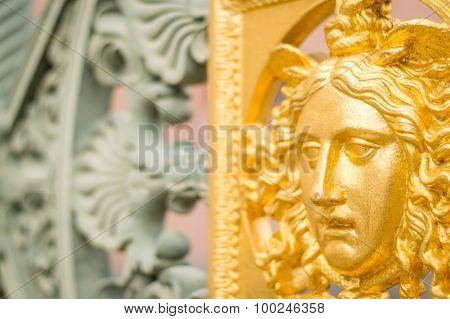 A Golden Metal Face