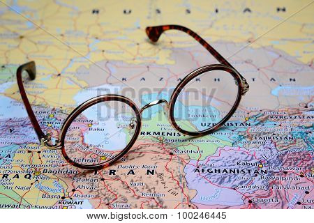 Glasses on a map of Asia - Tehran