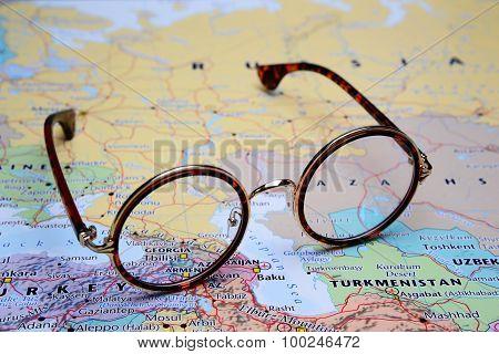 Glasses on a map of Asia - Georgia