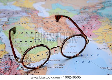 Glasses on a map of Asia - Yemen