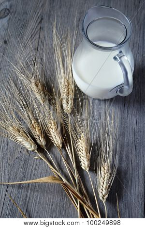 Jug Of Milk And Bred Grains