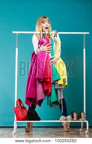 Funny Woman Taking All Clothes In Mall Or Wardrobe