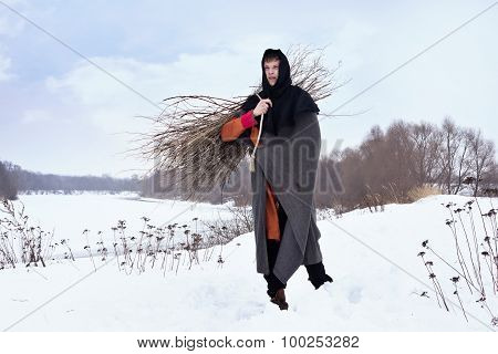 Medieval Peasant With A Firewood  Bundle