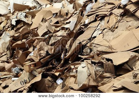 Cluttered cardboard in landfill