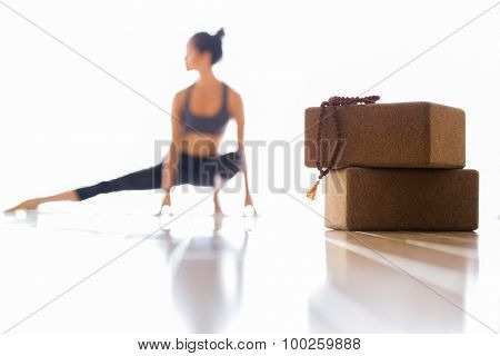 Woman practicing yoga indoors. Side stretch for flexibility.