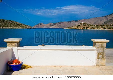 Panormitis. Wharf. Symi island near Rhodes. Greece. Small bay, white wall and mountains