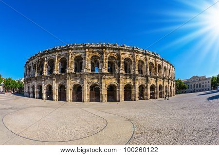 Magnificent huge arena perfectly preserved for two thousand years. Roman amphitheater in Nimes, Provence. Photo taken fisheye lens
