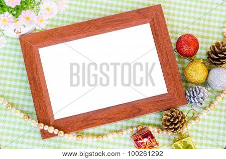 Wooden Photo Frame And Christmas Decoration With Flower.