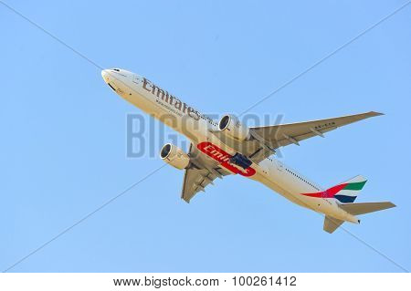 HONG KONG - APRIL 15, 2015: Emirates Boeing 777 take off. Emirates is one of two flag carriers of the United Arab Emirates along with Etihad Airways and is based in Dubai.