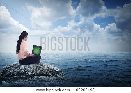 Business Woman Sitting On The Top Of The Rock