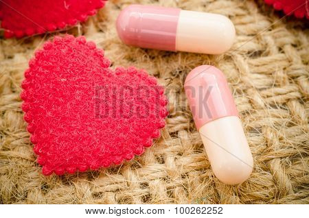 Capsule Pill And Red Heart.
