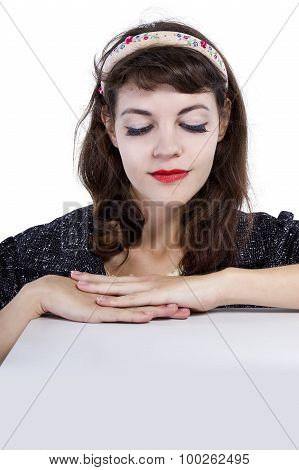 Woman Leaning on a Table