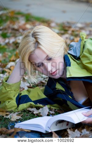 Beautiful Blonde College Girl Studying In Fall