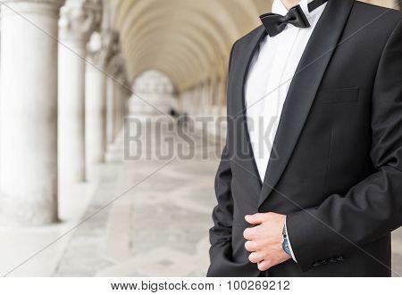 Elegantly dressed man in tuxedo