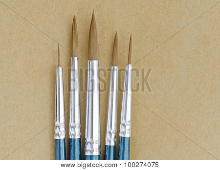 Paint Brushes On Brown Paper