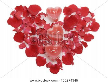 Red Candles  In Rose Petals Laid Out In The Form Of Heart.