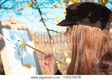 Portrait Of A Young Beautiful Woman With Brush In Her Hand