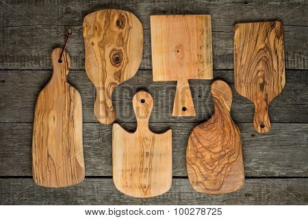Wood chopping boards on rustic wooden background