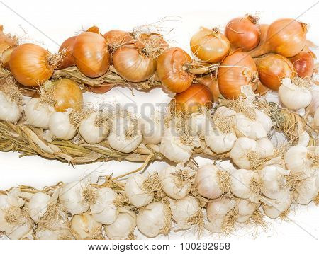 Bundle Of Onions And On Garlic A Light Background Closeup