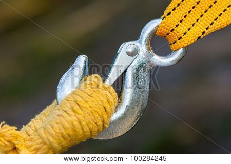 Steel hook and yellow rope and strap