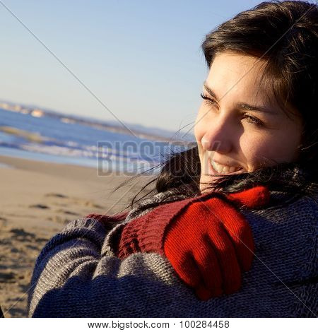 Happy Woman Enjoying Sunset On The Beach In Winter