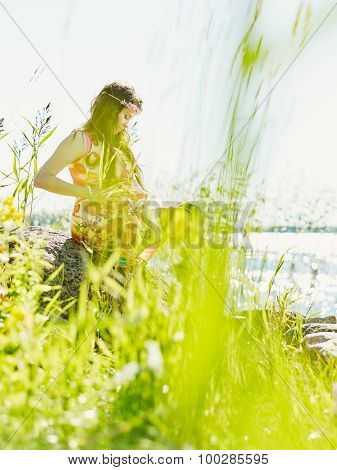 Beautiful Pregnant Woman And Shore