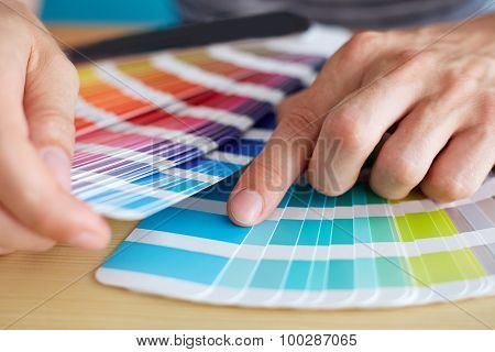 Graphic Designer Choosing A Color