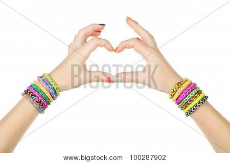 Female Hands In Shape Of Heart With Colorful Rubber Band Bracelets