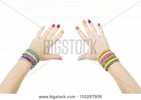 Loom Bracelets On Hands Of Young Girl