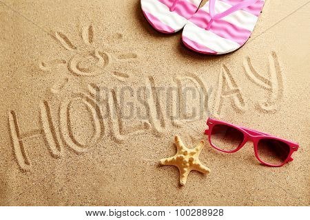 Holiday Written In Sand At The Beach