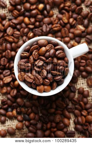 Coffee Beans In Cup On A Sack, Close Up