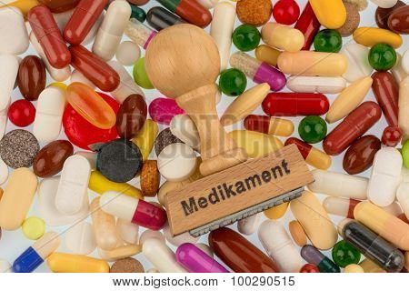 stamp on colorful tablets photo symbol for drug therapy and medical prescription