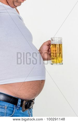 man with overweight. symbolic photo for beer belly, unsuccessful dieting and eating the wrong foods.