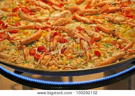Spanish Paella With Prawns And Rice Cooked On A Large Pot