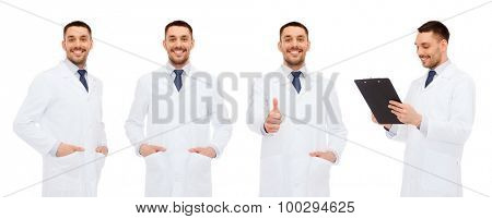 medicine, profession and health care concept - happy doctors with clipboard showing thumbs up