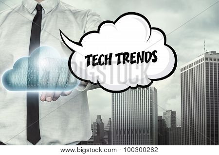 Tech trends text on cloud computing theme with businessman