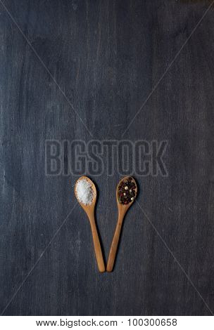 Two Wooden Spoons With Salt And Pepper
